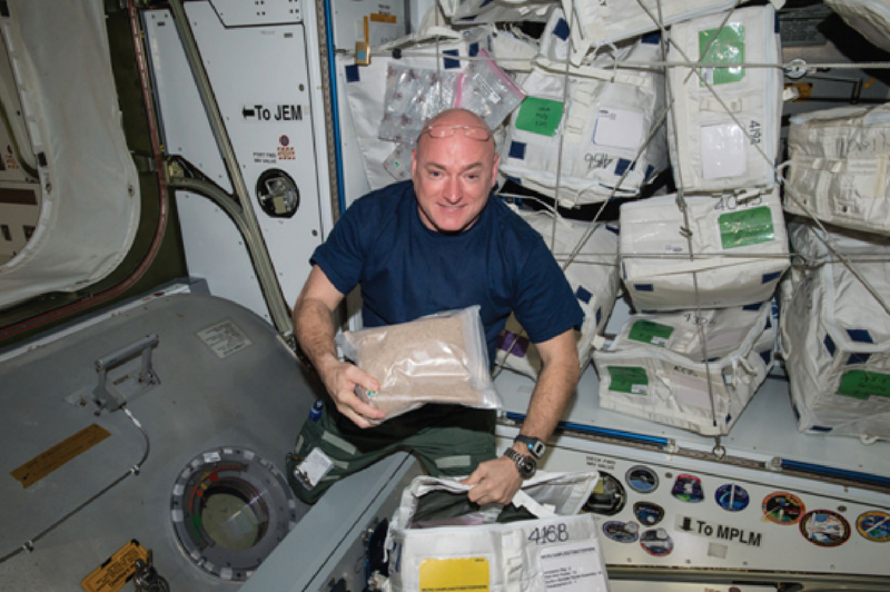 Former U.S. astronaut Scott Kelly on board the International Space Station with tomato seeds from the Tomatosphere project