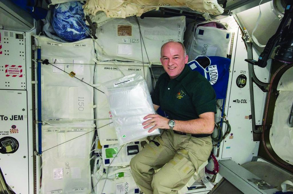 Astronaut Jeff Williams on board the International Space Station with the 1.2 million TomatosphereTM tomato seeds.